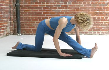 bar-method-thigh-stretch-on-mat.jpg