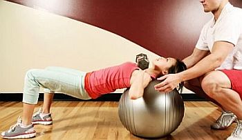 dumbbell-chest-press-on-exercise-ball-personal-trainer.jpg
