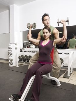 girl-shoulder-press-with-spotter.JPG