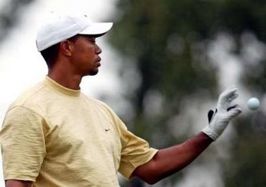 tiger-woods-catches-golf-ball.jpg