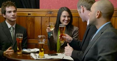 woman-drinking-beer-in-pub.JPG