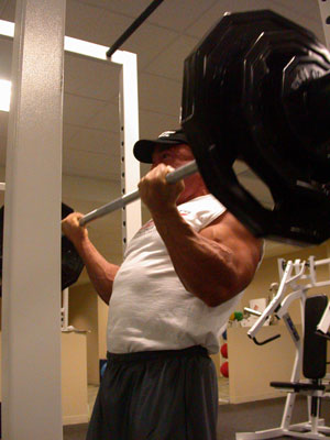 biceps-curl-with-heavy-barbell.jpg