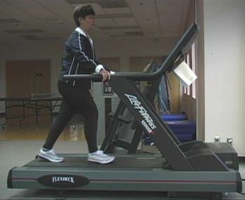 holding-handrail-of-treadmill.jpg