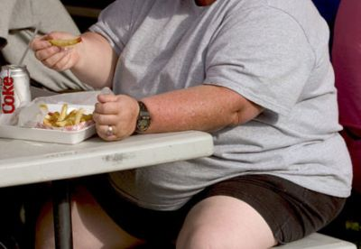 obese-man-with-chips-and-coke.jpg