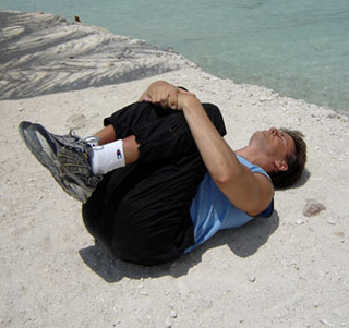 lying-lower-back-stretch-man-seaside.jpg