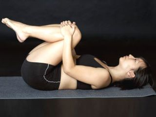 lying-lower-back-stretch-woman.jpg