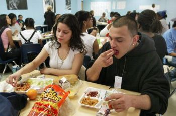 students-eating-fast-food-in-cafeteria.jpg