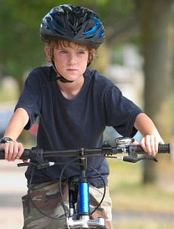 kid-wearing-helmet-riding-bicycle.jpg