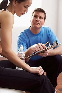 personal-trainer-assess-fitness-level-and-record-health-history.jpg
