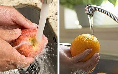 washing-apple-orange-under-running-tap-water.jpg